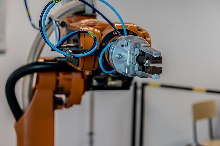 A robotic arm used for fitting together an electronic device such as a smartphone.