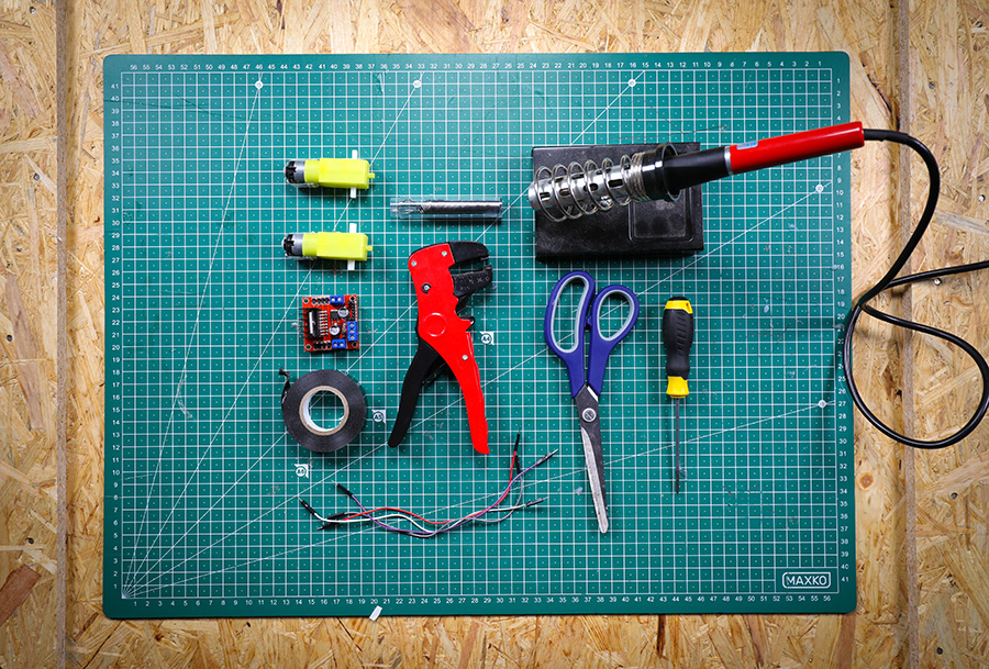 The robot buggy parts for this step - 2 x DC motors, Motor controller board, 4 x Jumper leads (male-to-male and female-to-male), Screwdriver, Soldering iron and solder, Wire strippers, Scissors, Tape