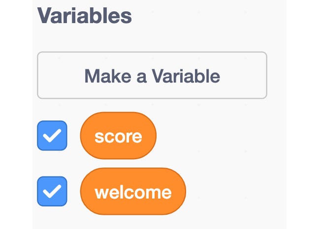 An image showing the score and welcome variable in the blocks palette of Scratch