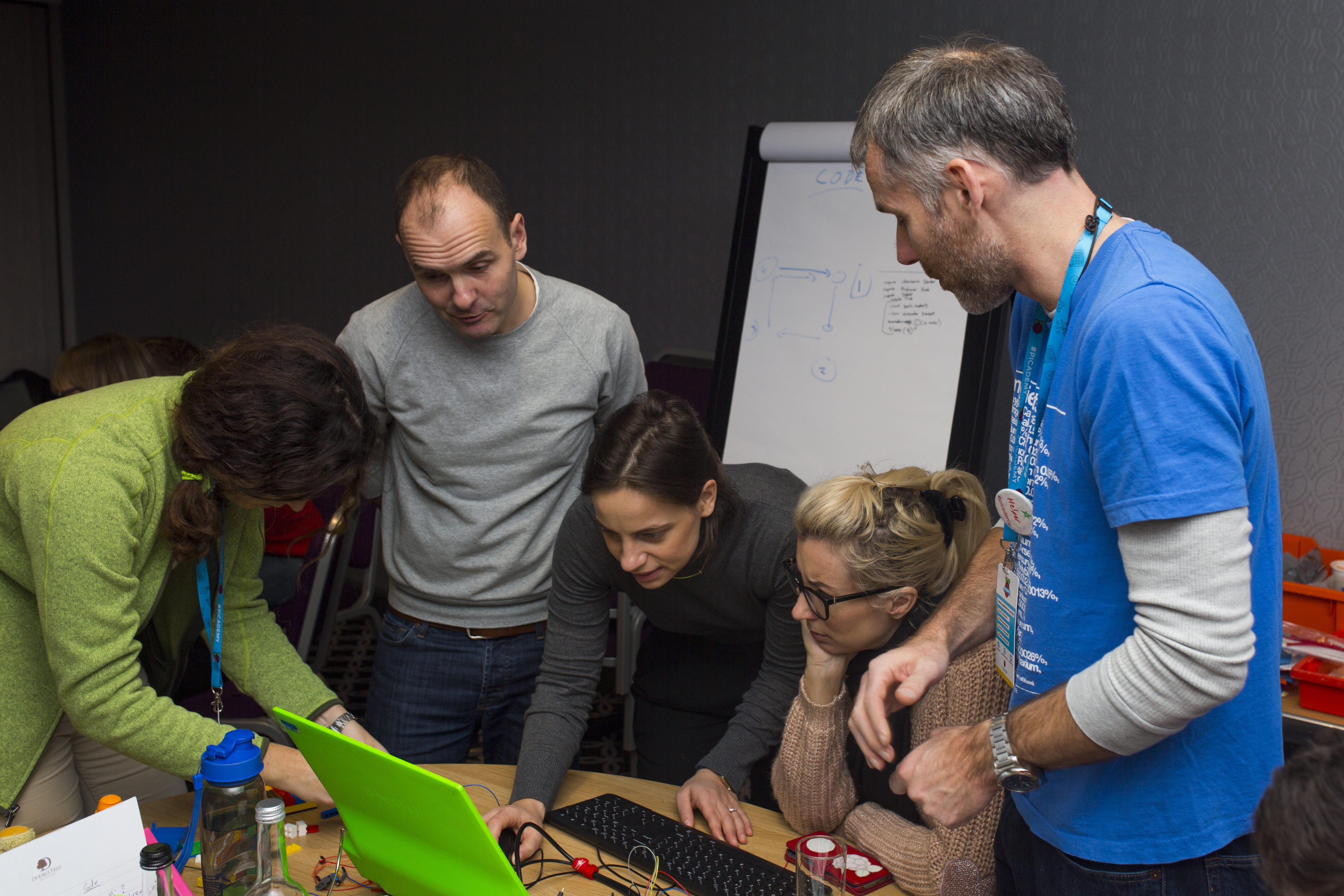 Users designing a physical computing project, gathered around a table