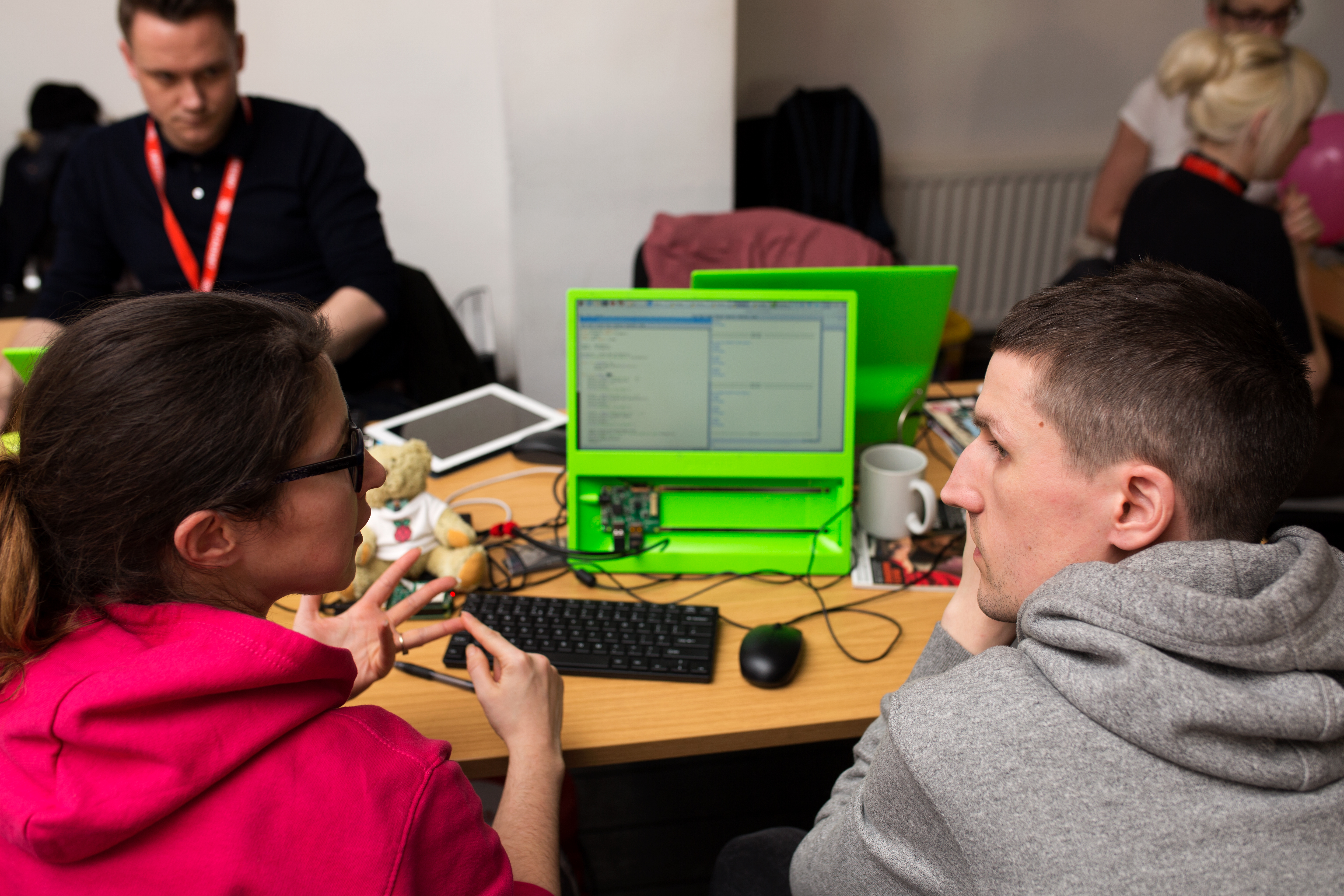 A pair of makers, imagining the plans for their physical computing project.