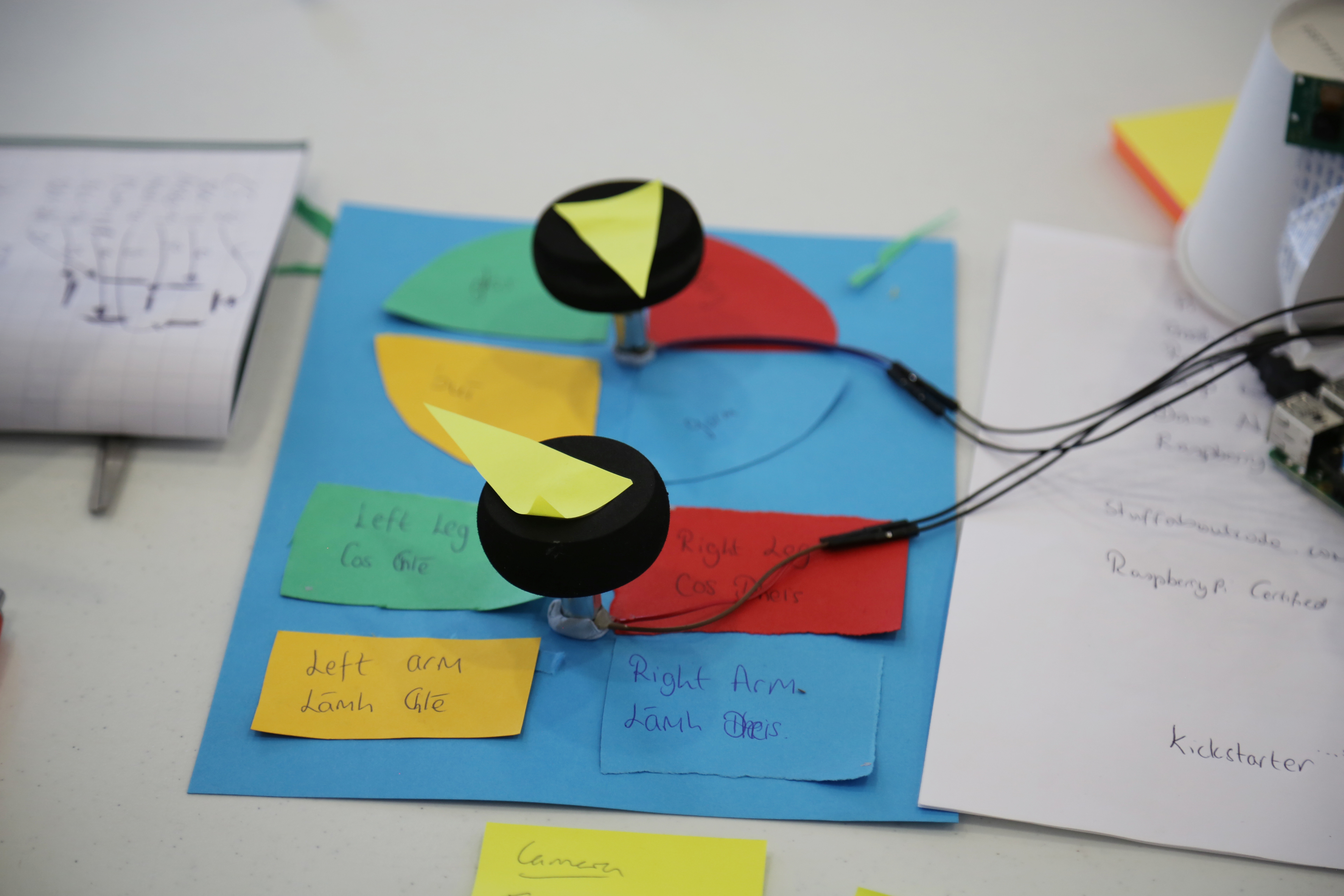 """A physical computing project, consisting of two motors which spin """"pointers"""" which give instructions for a game."""