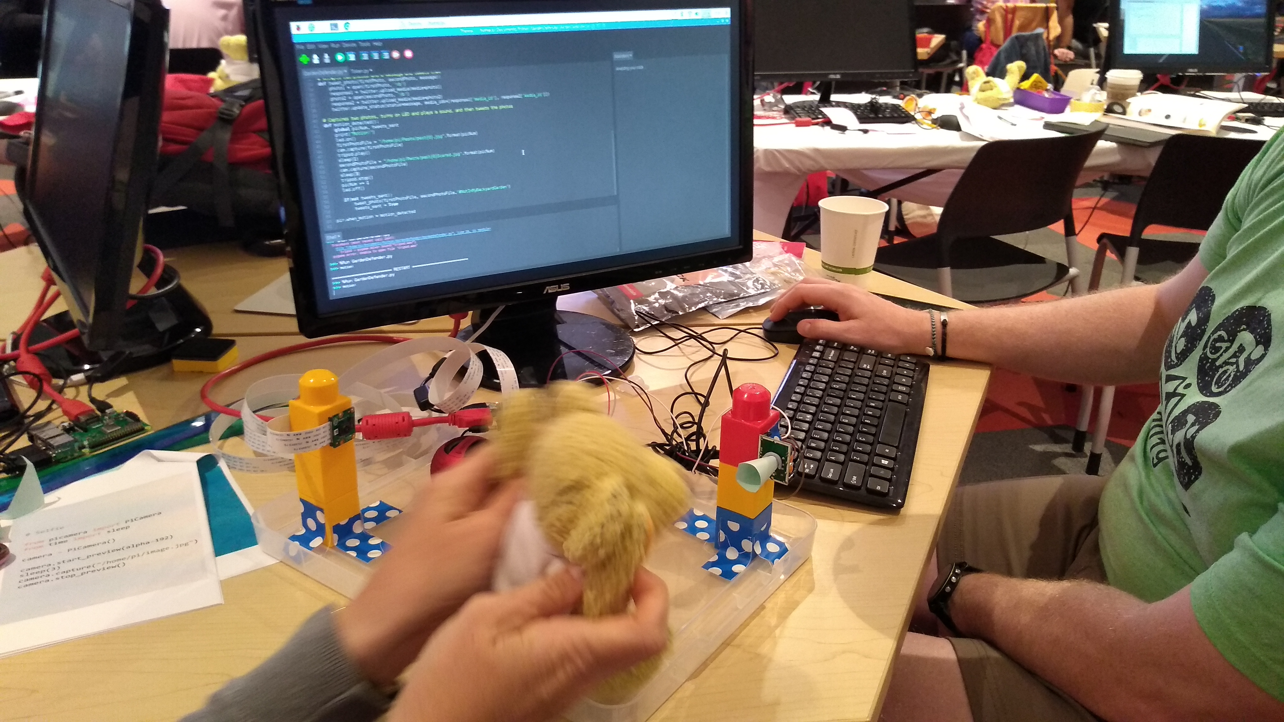 Image of a user watching a physical computing project - performing tests to ensure it works