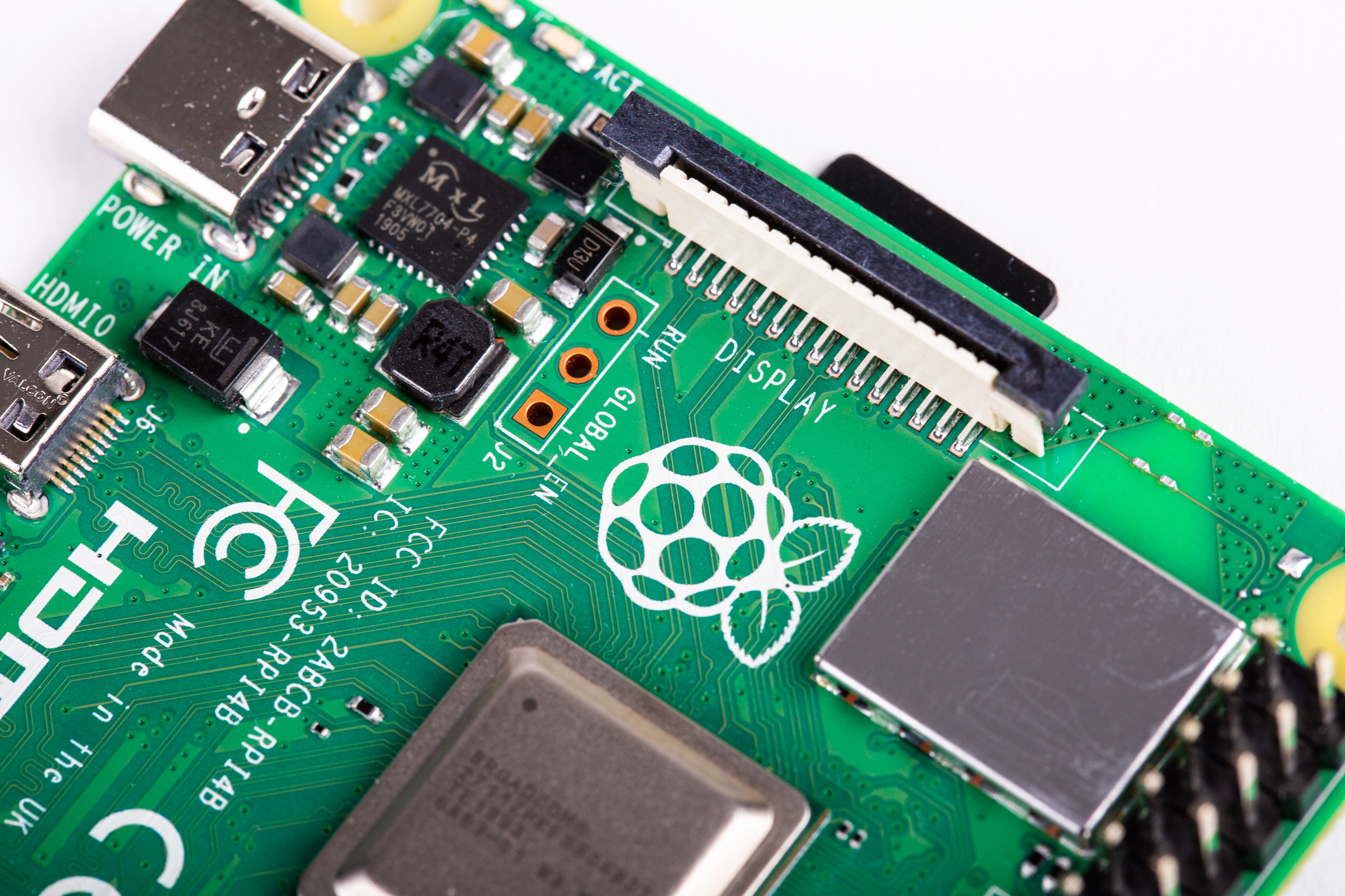 A close-up of a Raspberry Pi, showing the CPU and a HDMI port.